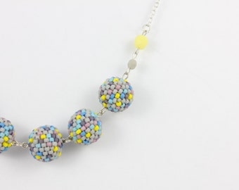 SALE Handmade Sterling Silver Necklace with Woven Beads. Multi-Coloured. By Detail London.