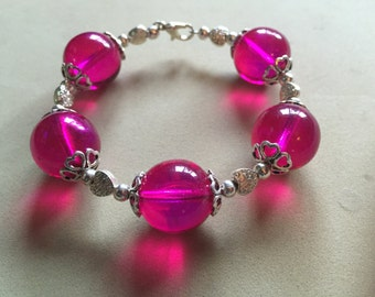 Bracelet Handmade with Fuchsia Pink Glass Beads and heart charms.