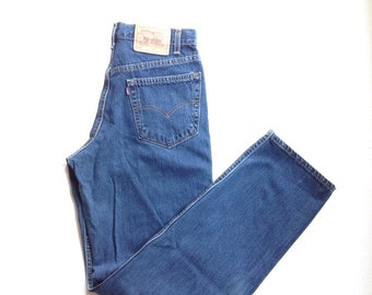 Vintage levis 550 jeans natural dark wash, relaxed fit jeans. Made in usa. W32 L34