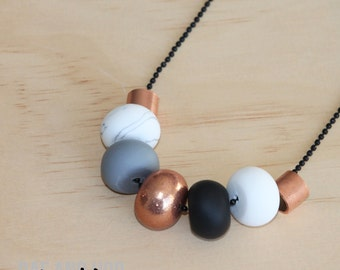 "Polymer clay necklace. Polymer clay bead necklace. Marble, copper, grey, black, white and copper metal beads! ""the bella"" 7 beads"