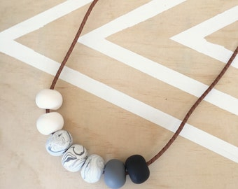 Polymer clay bead necklace marble, black, grey, white on braided leather