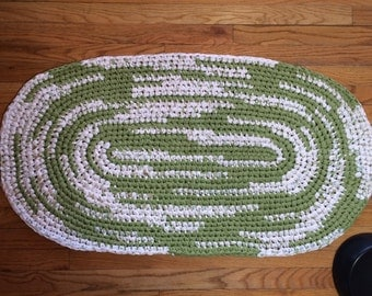 """This one of a kind handmade croteched green and white cotton rag rug is approximately 40.5"""" x 22.5""""."""