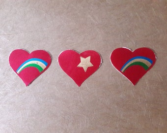 Three satin heart stickers from the 1980's