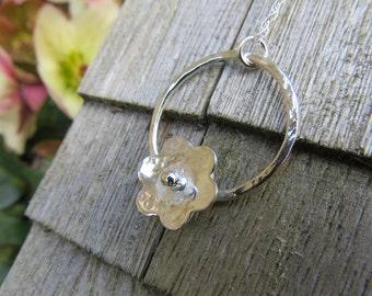 Handmade sterling silver flower pendant.