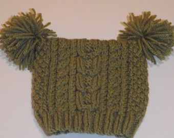 Hand knitted cosy cabled hat