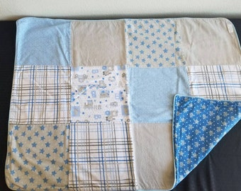 Soft flannel blanket with matching pillow.