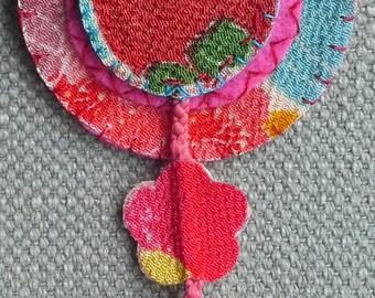 Textile pin, esptit Japanese. Warm colors.