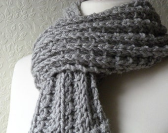 Chunky hand knitted silver grey scarf in a wool and alpaca mix yarn