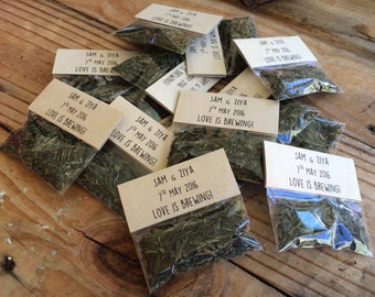 PACK OF 75, 'love is brewing' tea wedding favour