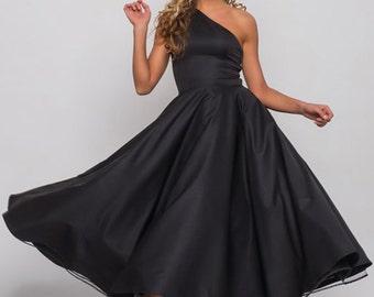 Dark blue dress, light beige dress, midi length dress with asymmetry, flared dress, full skirt, formal dress