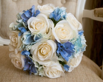 Blue and ivory silk wedding bouquet. Made with artificial roses, delphinium and hydrangea.