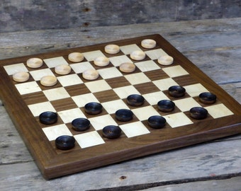 Checkerboard with wooden checkers   checkerboard with solid walnut border