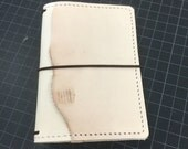 Nude with natural edge external pocket