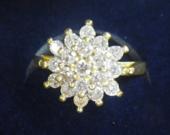 A vintage 18 ct yellow gold 1/2 ct diamond cluster ring