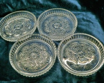 1950s Set of four glass coasters  USED