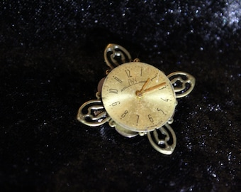 Steampunk style brooch with large round clock face