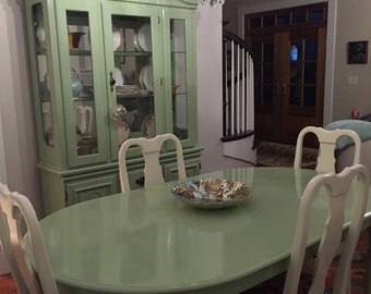 Beautiful French inspired light washed dining table, chairs and china cabinet for a bright fun country feel..