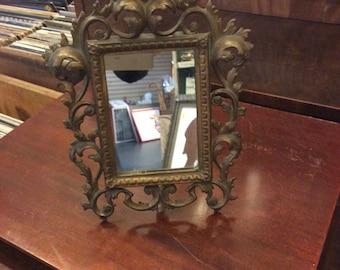 Brass boudoir mirror