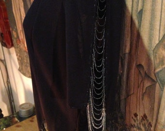 Vintage jersey beaded top. Unusual swags on sleeves and hem. Black. Quality 40 bustx 26 long
