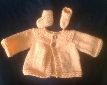 Hand knitted peach newborn sweater set
