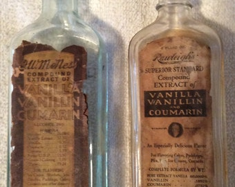 2 Vintage Glass EXTRACT Bottles --  RAWLEIGH'S and F.W.McNESS