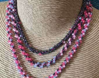 Three strand, pink, blue, black, glass bead crocheted necklace