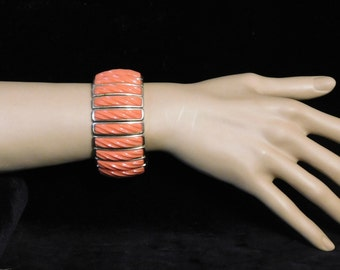 Cool orange 1960's bracelet-- thermoset plastic on expandable wristband