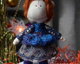 Doll monkey in blue dress