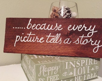 because every picture tells a story wood sign