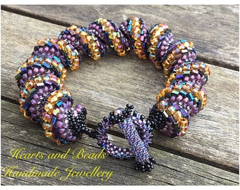 Purple,black and gold coloured Cellini spiral, beaded, woven, twisted, spiral, chunky bracelet