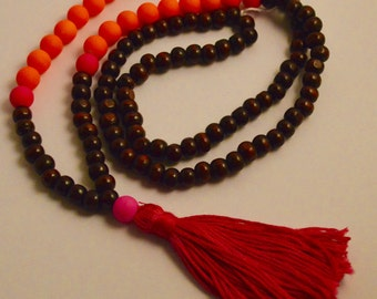 Orange and pink beaded necklace with pink tassel