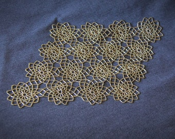 Gold beaded doily