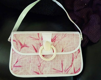 """LULU GUINNESS genuine original handbag pink design with white trimmings never been used comes with dust bag size 12""""x8"""