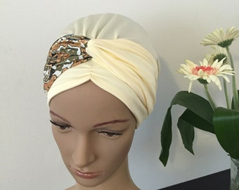 No tie sinar tichel apron style headcovering mitpachat snood bandana with built in headband in cream brown orange