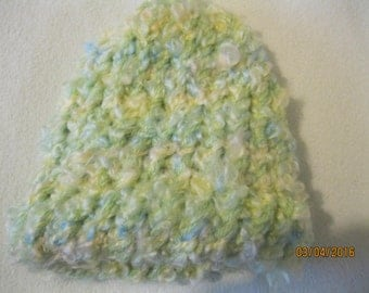 yellow, blue and green fuzzy baby hat