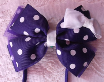 Little bow boutique (Purple with white polka dots stacked hair bow)