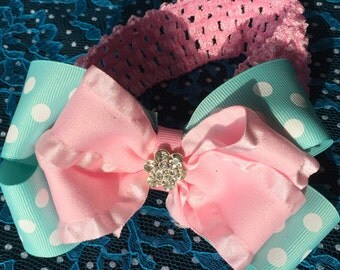 Headband with bow attached