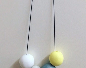Natural tone polymer clay necklace with a •• POP •• of yellow.