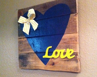 Rustic blue and yellow love sign with yellow striped bow
