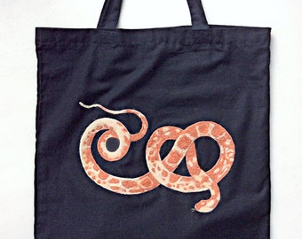 needle felted snake on a tote bag