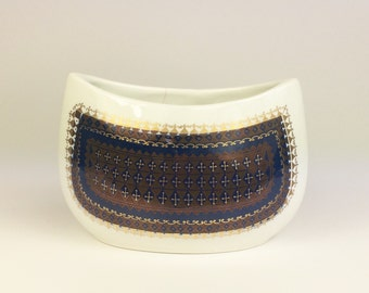 A crescent shape bowl/vase by Arabia of Finland