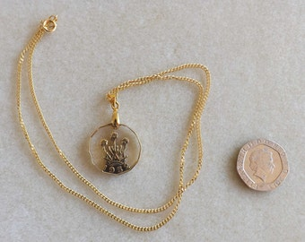 Hand-cut coin, gold-plated, British 3d coin pendant, showing the 'thrift' plant and dated 1952