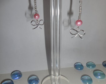 pink pearl and bow earrings