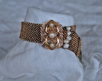 Gold slide bracelet with pearls and ladies fob