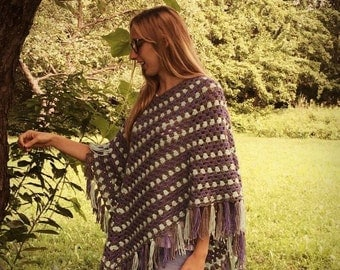Knitted poncho was hand