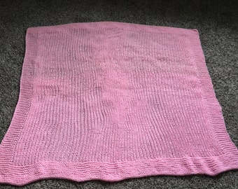 Knitted pink baby blanket