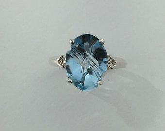 Oval Fantasy Cut Blue Topaz Set in Sterling Silver Ring MR1612