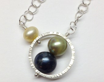 Sterling silver necklace with freshwater pearls