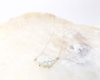 Silver feather charm necklace