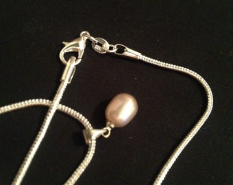 Large Cultured Pearl on a Sterling Silver chain.